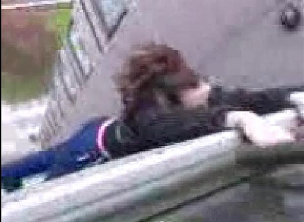 News Shopper: Idiotic: The girl hangs from the balcony while her friend films