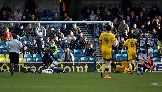 Lions stopper David Forde denies Leonardo Ulloa in the first half. Picture by Edmund Boyden.