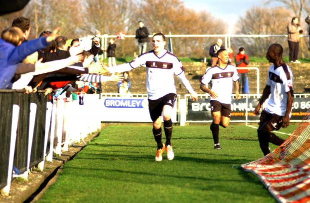 Danny Waldren heads to the crowd after firing Bromley 2-1 in front