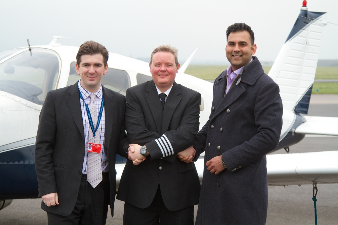 (LR) Robert Walters, Captain Gary Merchant, and scholarship administrator Anoop