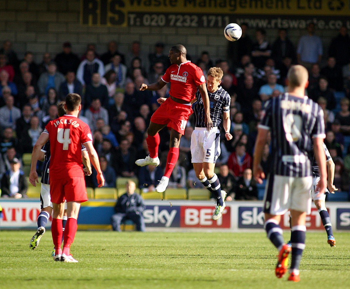 Marvin Sordell beats Paul Robinson to a header. Picture by Edmund Boyden.