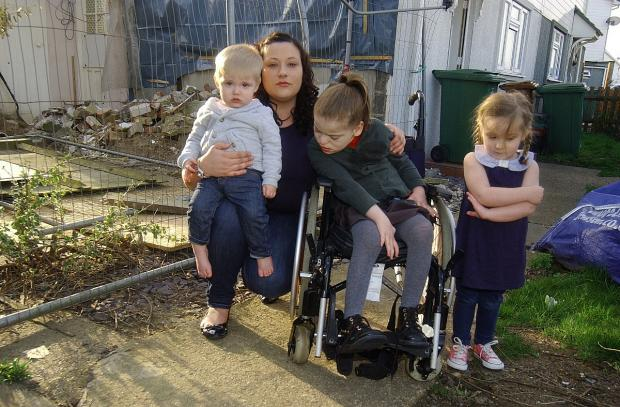 News Shopper: Mum of disabled child left with 'building site' of a home as extension halts for 14 weeks