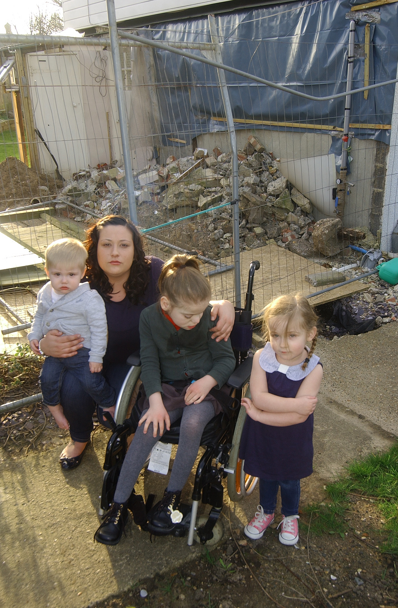 Mum of disabled child left with 'building site' home as extension stops for 14 weeks