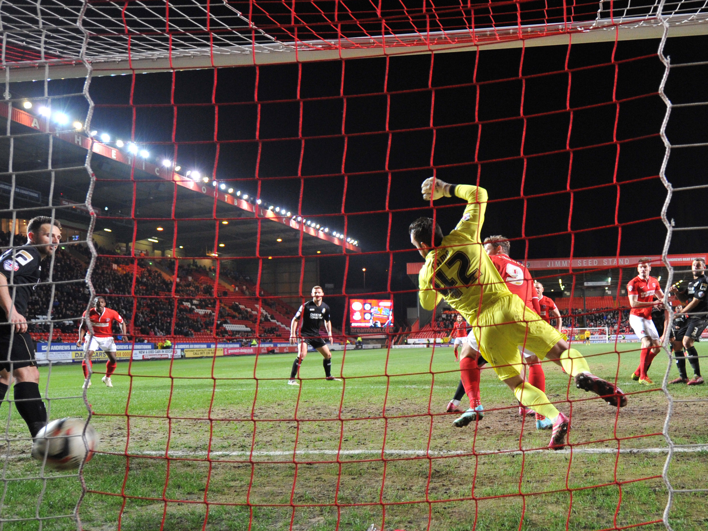 Bournemouth keeper Lee Camp is beaten by Dorian Dervite's late winner. Pictures by Keith Gillard.