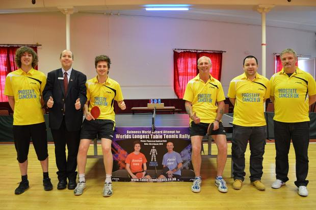 News Shopper: Daniel Ives, 24, pictured third from left, and Peter Ives, 50, pictured third from right celebrate after breaking the Guinness World Record for the longest table tennis rally