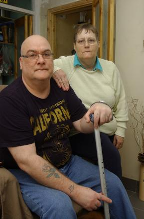 Terry Devine, who is disabled, says it is 'criminal' Greenwich has left him in a flat with mould and damp, pictured with wife Debora Devine