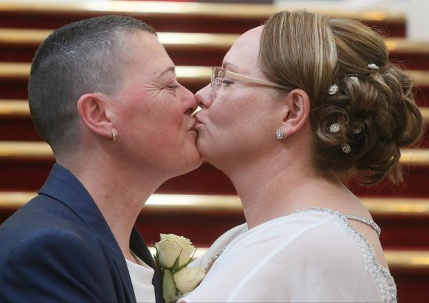 News Shopper: Carol McCarron, left, and Charlotte Wood, right, celebrated their marriage at Woolwich Town Hall on March 29