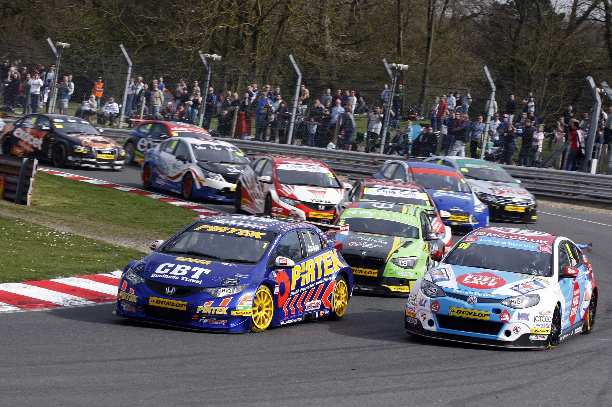 News Shopper: Andrew Jordan and Jason Plato lead into the Paddock bend in race one