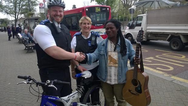 PCSOs Tommy Fuller and Julie Oldfield with Dedan Kamau