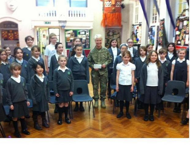 News Shopper: Royal Artillery Band donated cash to help the Deansfield Primary School choir