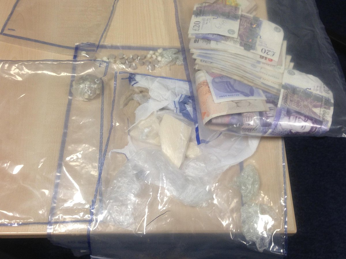 The heroin, crack cocaine and cash found on a man during a Lewisham police street stop