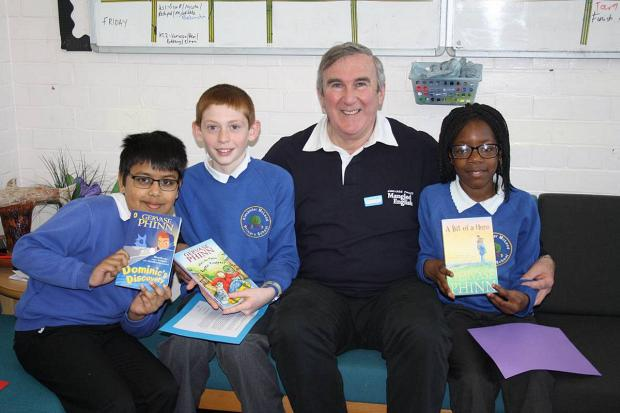 News Shopper: Retiring Abbey Wood headteacher felt like 'a little boy on Christmas Day' during surprise author visit