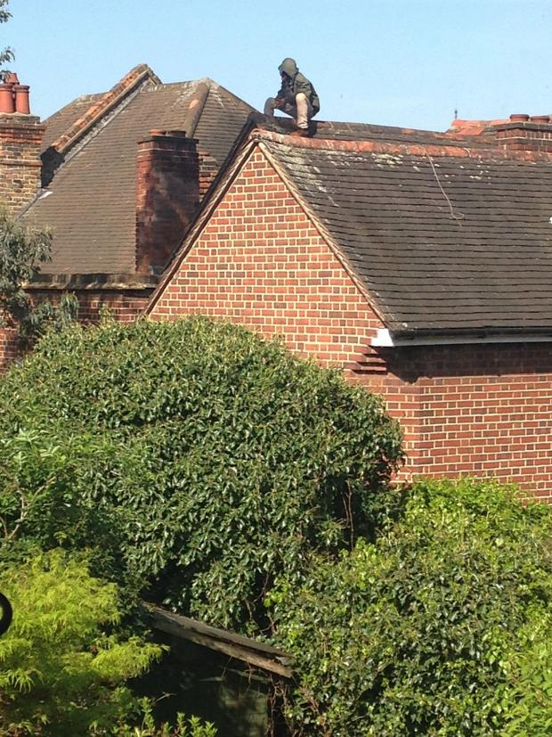 News Shopper: The man on the roof this morning, picture courtesy of Edward Parker Humphreys
