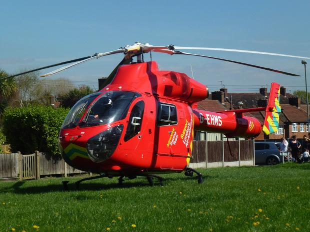 The air ambulance lands in Hassop Walk