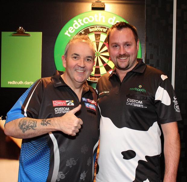 Paul Amos (right) with darts legend Phil 'The Power' Taylor