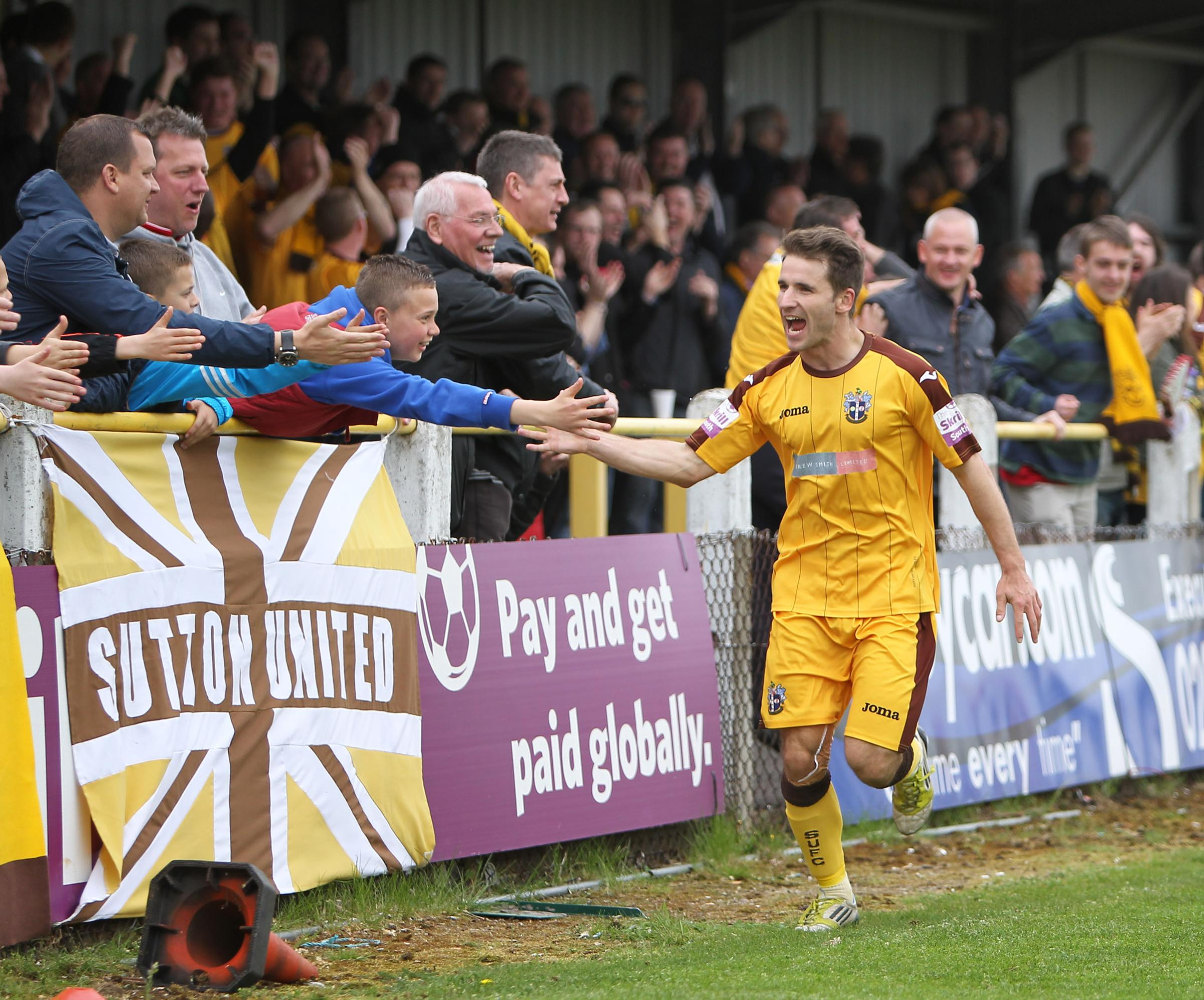 Jamie Taylor celebrates after equalising for Sutton. Picture by Paul Loughlin.