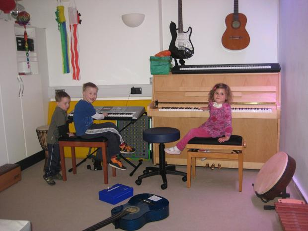 News Shopper: The music therapy room, pictured L-R Connor, Thomas and Phoebe