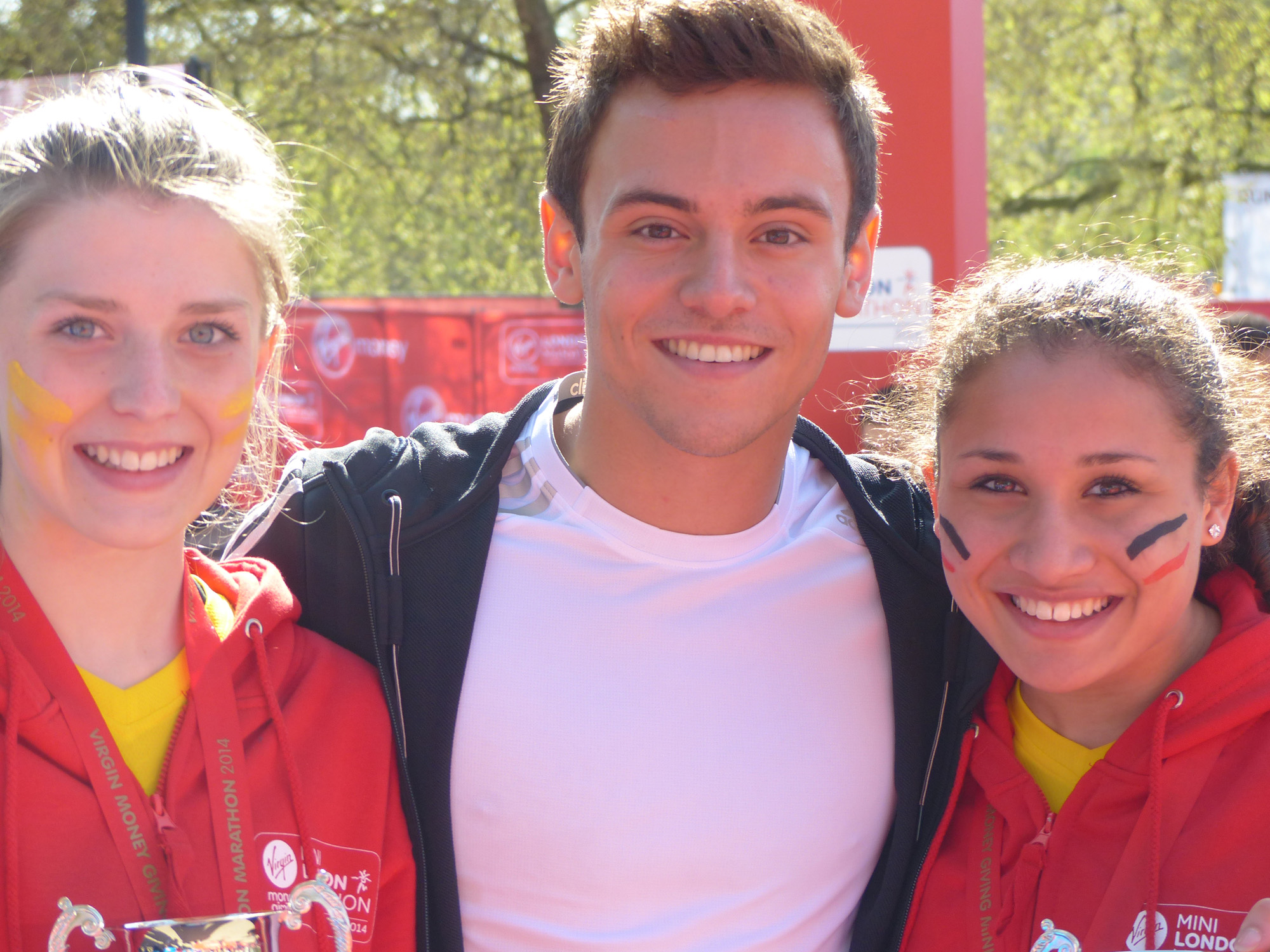 News Shopper: Sabrina Sinha (right) receives her medal from Tom Daley