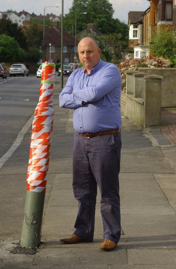 News Shopper: Burnt Ash Lane resident Mike Cripps next to the broken lamppost