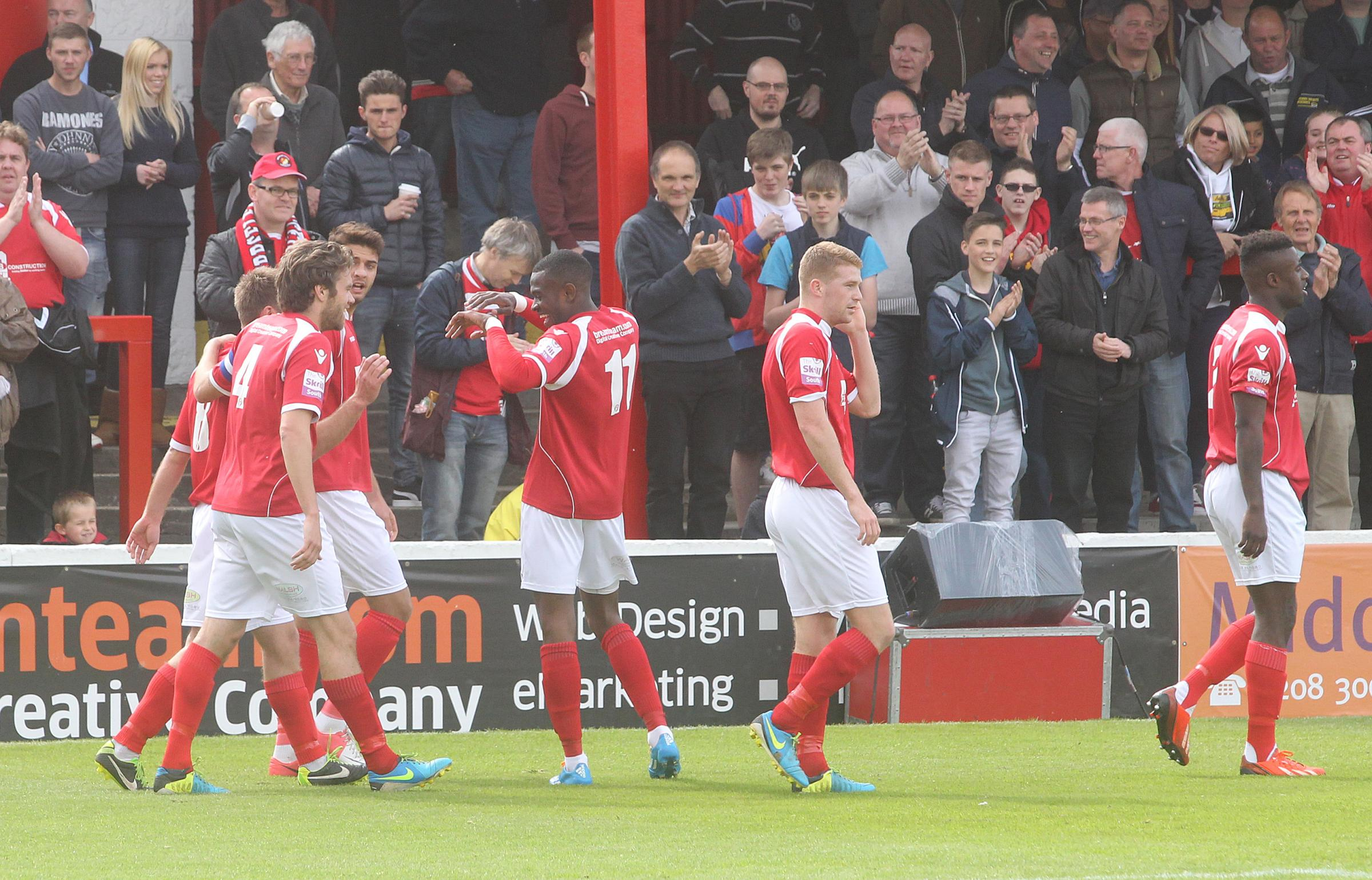 News Shopper: Daryl McMahon is congratulated after putting Fleet in front