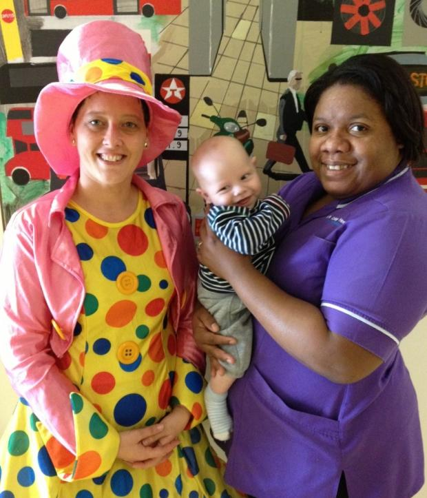 News Shopper: Play specialist Sian Spencer-Little, four-month-old Sam Allison, a patient, and Cavette Castillo.