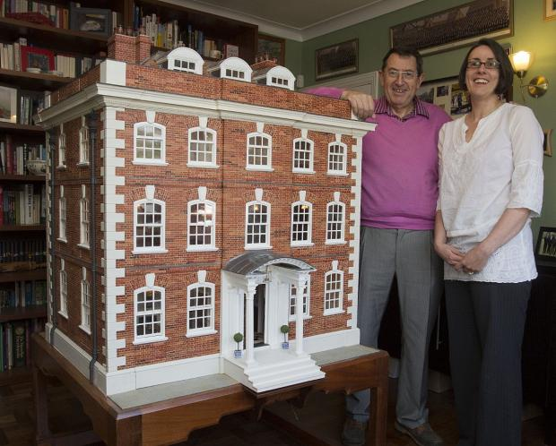 Geoffrey Walkley with daughter Sarah and the dolls house