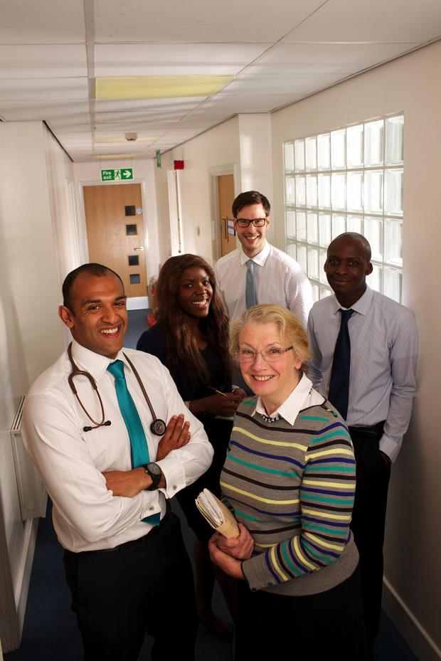 News Shopper: Some of the doctors at St Johns Medical Centre, Dr Chrisanthan Ferdinand pictured front left, Dr Jean Parker pictured front right