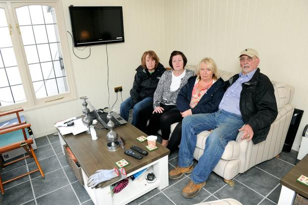 News Shopper: Some residents affected by the flood, pictured in the Seago's summer house. L-R, Rosemary Clay, Angela Barrow, Kathy and Fred Seago,