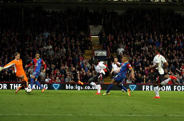News Shopper: Dwight Gayle slips the ball under Simon Mignolet to make it 3-3. Pictures by Edmund Boyden.