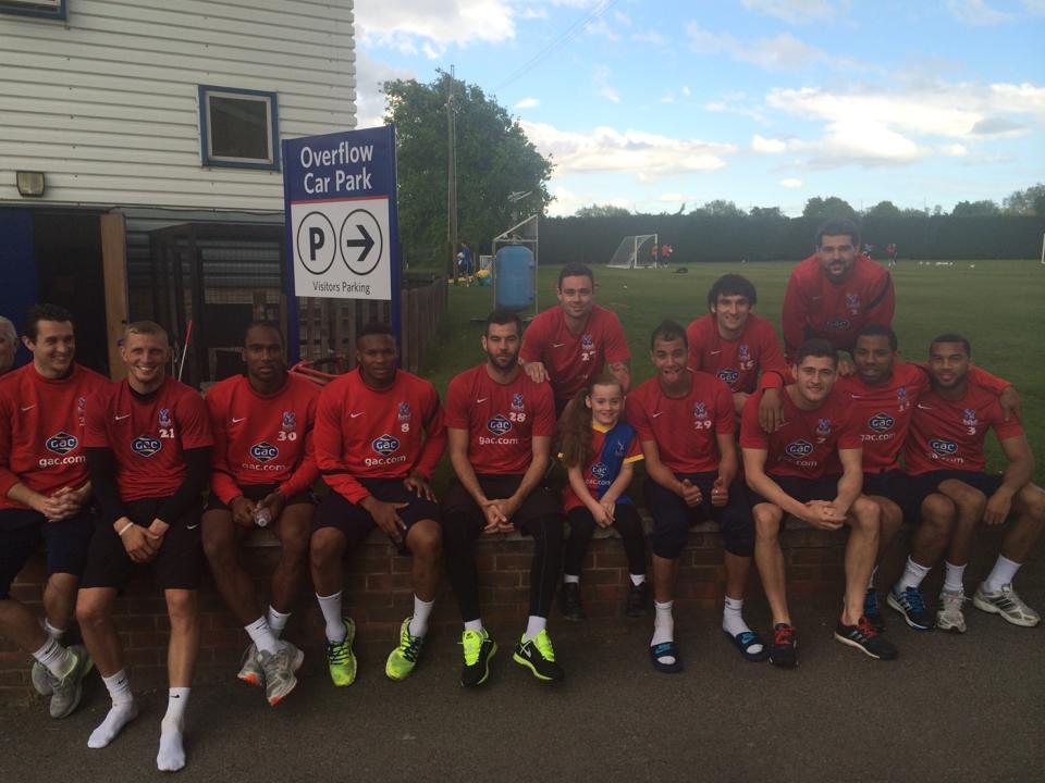 Scarlett with the team at the training ground