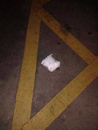 A picture of a soiled nappy, left in The Walnuts shopping centre car park
