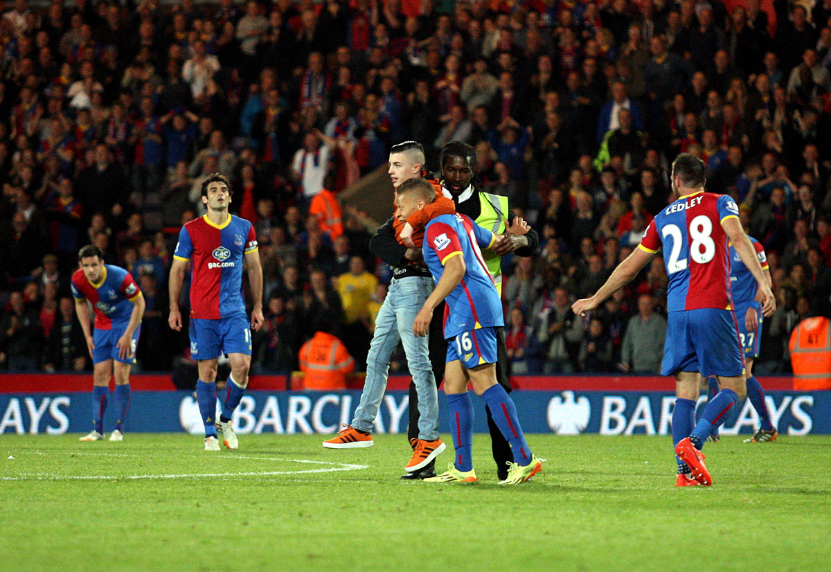 News Shopper: Dwight Gayle is congratulated by a young uninvited Palace fan after making it 3-2