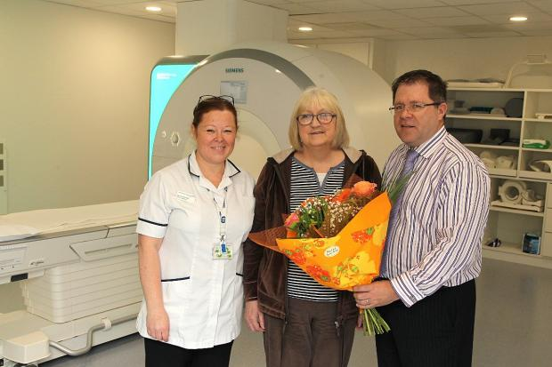 News Shopper: Pictured left to right: deputy radiographer Sarah-Jane Platt for MRI, first patient Pearl Morland to use scanner and Head of Imaging, Malcolm McNinch