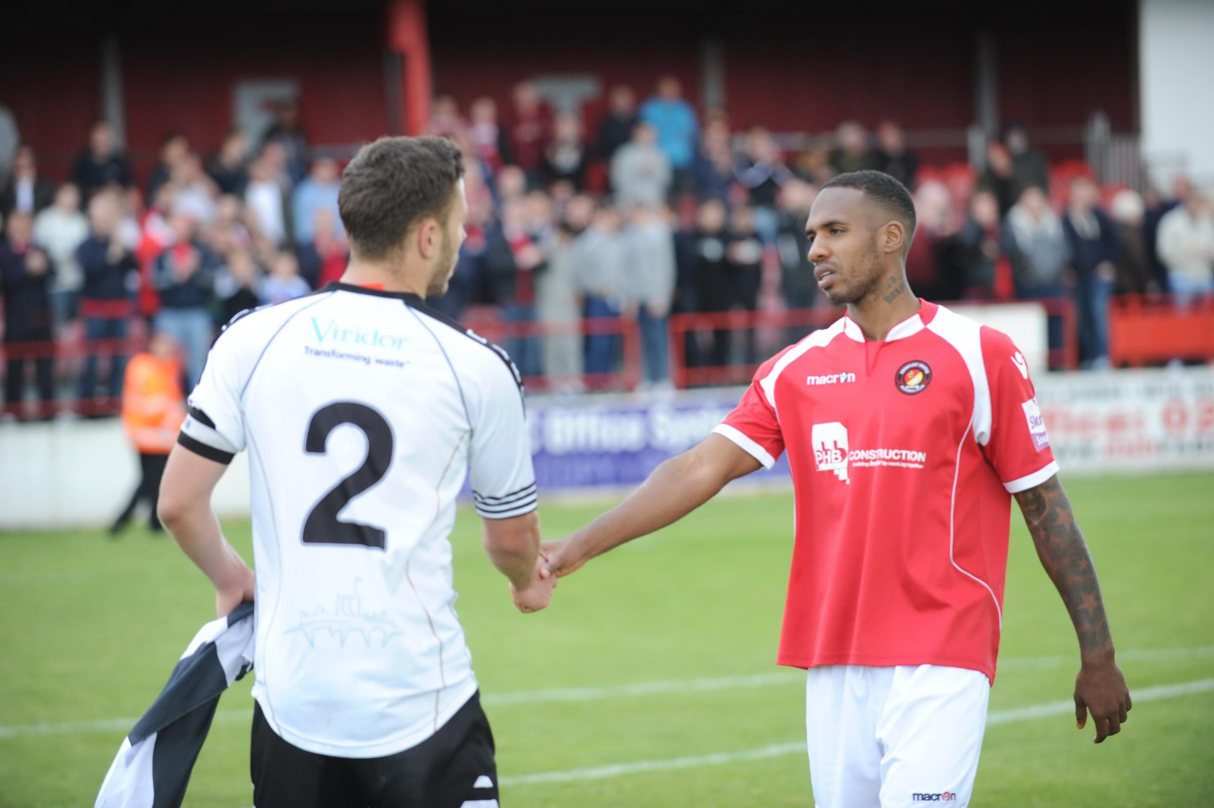 News Shopper: Aiden Palmer (right) shakes hands with Dover captain Craig Stone