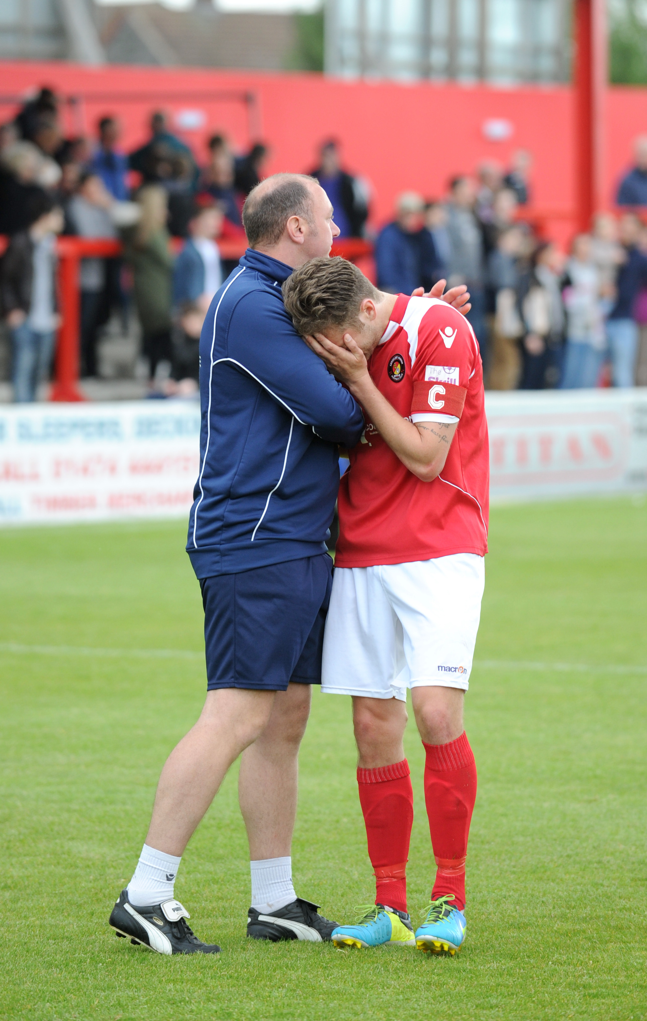 News Shopper: Daryl McMahon is consoled by Fleet coach david Jupp