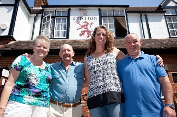 News Shopper: Yvonne Marsh (67), Terry Marsh with new pub licensee Wendy Stokley and her partner Mark Usher