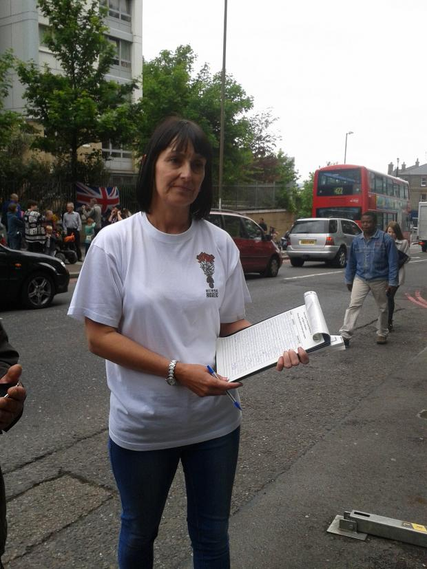 News Shopper: Lorna Taylor holding her petition for a permanent memorial to Lee Rigby in Woolwich