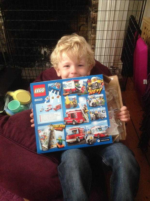 News Shopper: Lucky Milo with his birthday Lego set.