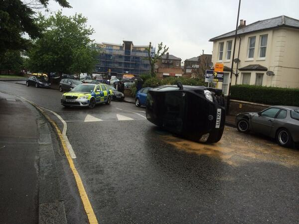 Car overturns 'after crashing into parked vehicle' (pic by @LRSSE)