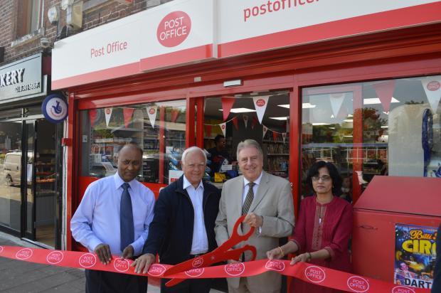 News Shopper: Mr Evennett revealed the updated store along with Dinker Patel, the owner, his wife and St Michael's ward Councillor Ray Sams.