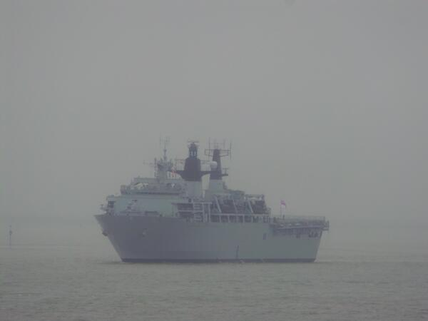 Warship HMS Bulwark passes through Gravesend Reach on way to Greenwich
