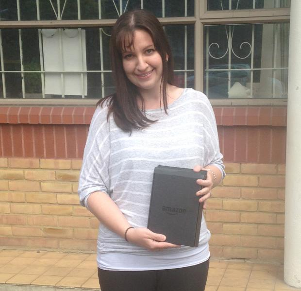 Scavenger Hunt competition winner Lisa Cole with her new Amazon Kindle