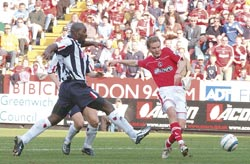 Jonatan Johansson scores Charlton's equaliser during the 4-1 defeat against West Brom at The Valley on Saturday