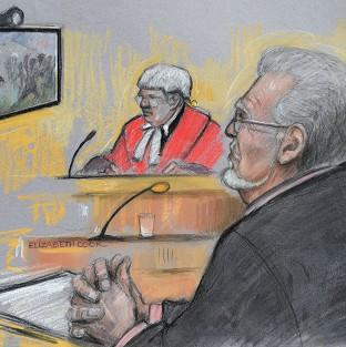 Court artist sketch of Rolf Harris being shown footage of a TV game show in which he appeared during the 1970s