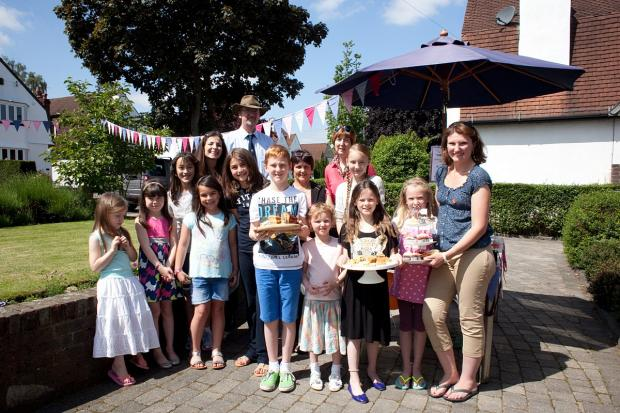 Natascha with friends, family and neighbours at her cake sale last Saturday