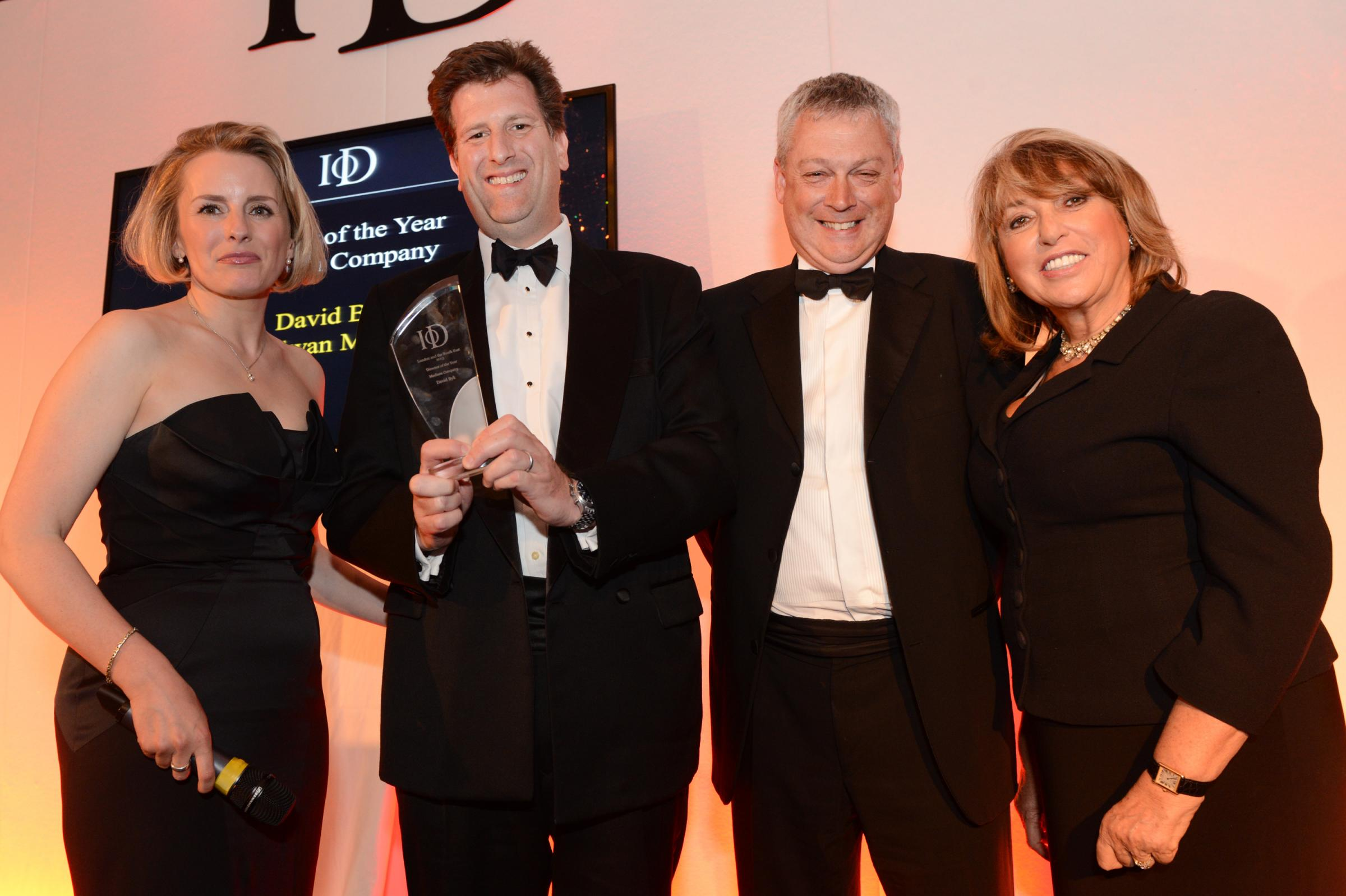 David Byk, second left, receives his award from (l-r) event host Polly Whitehouse of Channel 5 News, John Minards, South East Regional Leader of headline sponsors PricewaterhouseCoopers LLP, an