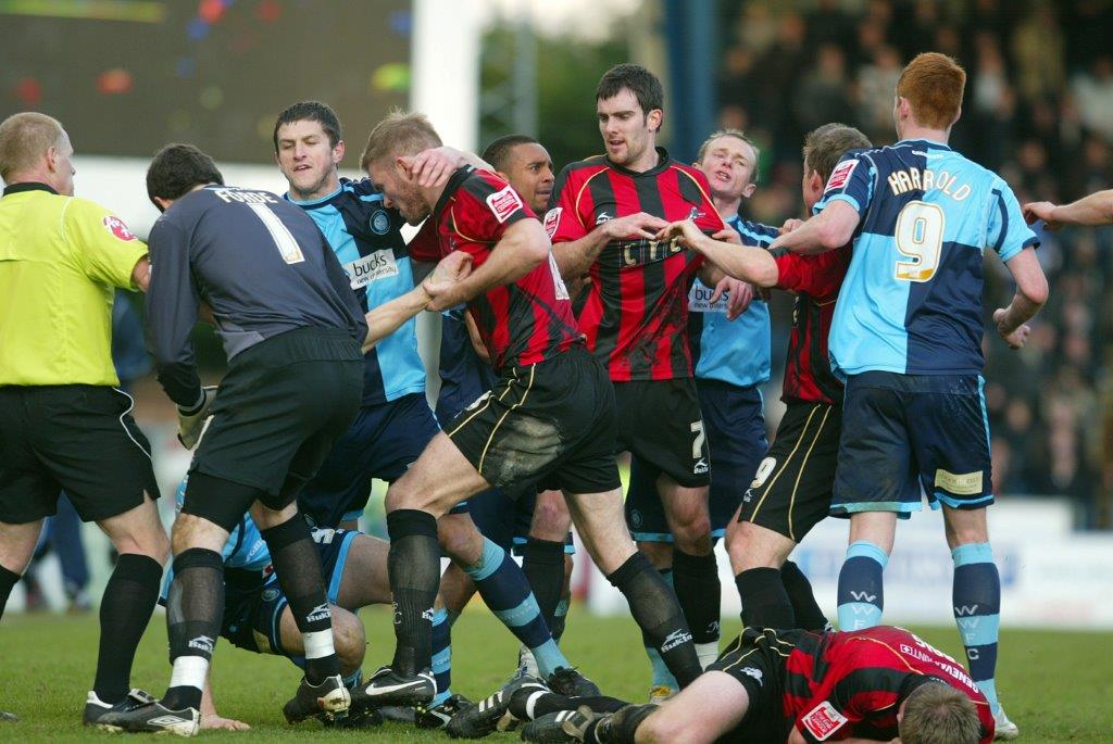 Tempers flare after Tony Craig is fouled by Gareth Ainsworth during Millwall's last meeting with Wycombe in February 2010