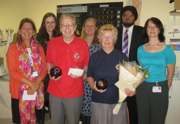 Sylvia Phipps donates around £2,400 to Woolwich's Queen Elizabeth Hospital cardiology department on behalf of Zipper Bowling Association