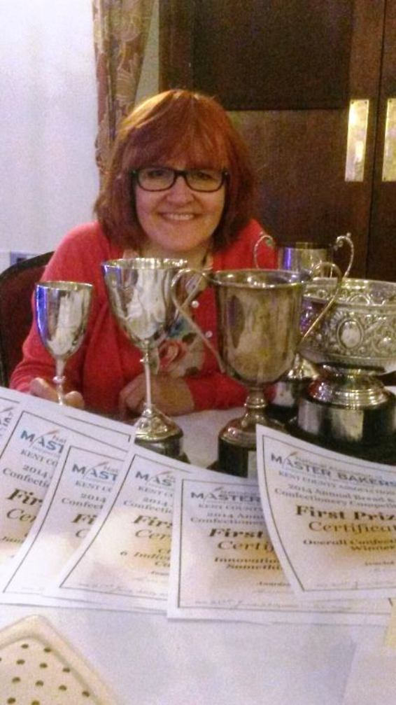 Debbie McFaul shows off her awards