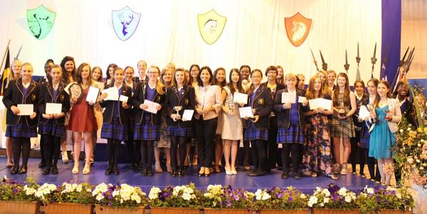 Mishal Husein (centre) with Cobham Hall's prize winners.